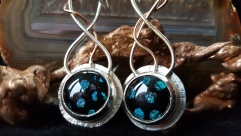 Spotted dichroic cabochons set on silver with twisted silver wire and copper detail
