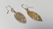 Silver holed leaf drop earrings £25.00