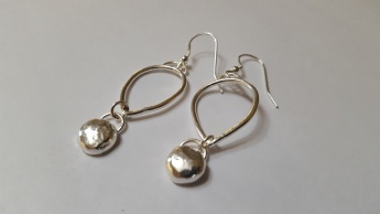 Silver Open petal, with a Solid Ball of Sterling Silver hanging at the base. Approx L 5cm. £75.00