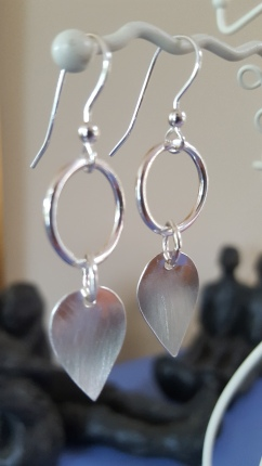 Drop earrings with Silver circles and small Brushed silver petals. L approx 48mm, W approx 15mm. £65.00