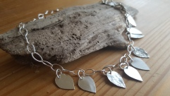 Necklace of Sterling silver Navette chain with delicate silver petals hanging £139.00