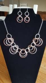 Heavy necklace of Sterling Silver and Copper loops linked together in a beautiful style. Hallmarked tag attached.