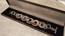 Heavy bracelet of Sterling Silver and Copper loops linked together. Hallmarked tag applied.