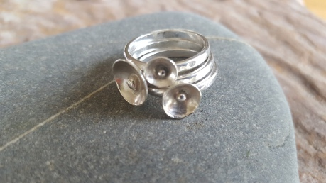 Set of stacking rings with 3 different size domes and silver centres, fit together beautifully or can be worn on their own
