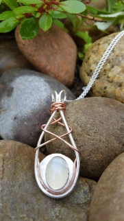 Moonstone festival pendant with copper wire detail