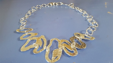 Irregular shaped hand sawn silver necklace