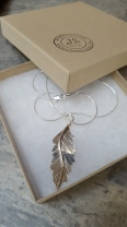 Hand sawn engraved feather pendant