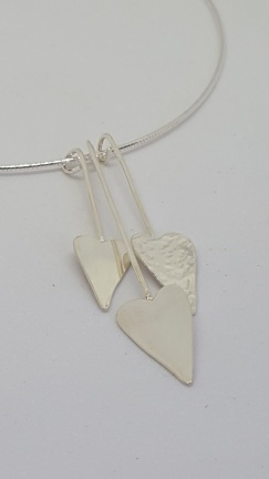 A set of 3 Silver hearts, modern design on a Silver Omega choker chain