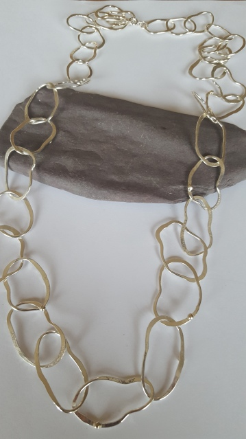 Rock pool necklace with multiple gold beads