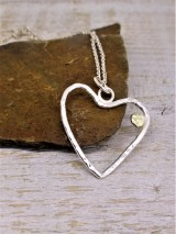 Delicate heart pendant with Large Solid Gold accent