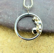 Silver Circle Pebble Pendant with Ecosilver and 9ct Ecogold pebbles